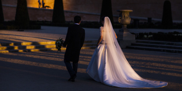 A married couple look for a location to take a wedding photo as people walk their dog during a sunset in Retiro Park in Madrid, Spain, Saturday, March 7, 2015. The Retiro Park, a beautifully tended 350-acre garden space where city-dwellers go to get away from the metropolitan hubbub lies in the heart of the city. Originally the formal gardens of a medieval palace, it became King Philip II's 16th-century refuge from court preoccupations, as well as his religious retreat. (AP Photo/Andres Kudacki)