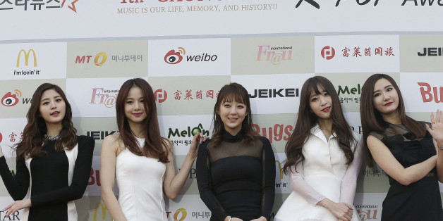South Korean K-Pop group EXID poses for photographers prior to the K-Pop Awards 2014 in Seoul, South Korea, Wednesday, Jan. 28, 2015. (AP Photo/Ahn Young-joon)