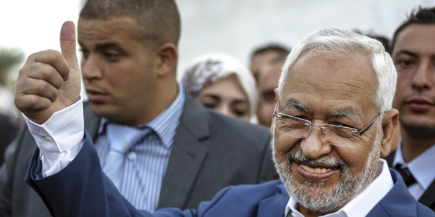 Rachid Ghannouchi, leader of the Tunisian moderate Islamist Ennahda Party, gestures before casting his vote at a polling station in Ben Arous, Tunisia, Sunday Oct. 26, 2014. Tunisians lined up Sunday to choose their first five-year parliament since they overthrew their dictator in the 2011 revolution that kicked off the Arab Spring. (AP Photo/Aimen Zine)