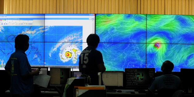 Meteorologists from the Philippine Atmospheric, Geophysical and Astronomical Services Administration (PAGASA) monitor and plot the direction of super typhoon Maysak at PAGASA headquarters in suburban Manila on April 1, 2015.  The typhoon has already ravaged the Pacific islands and is expected to hit the Philippines this weekend. Government weather forecasters are hoping it will weaken before it slams into the northern part of the archipelago which is already frequently battered by typhoons.  AFP
