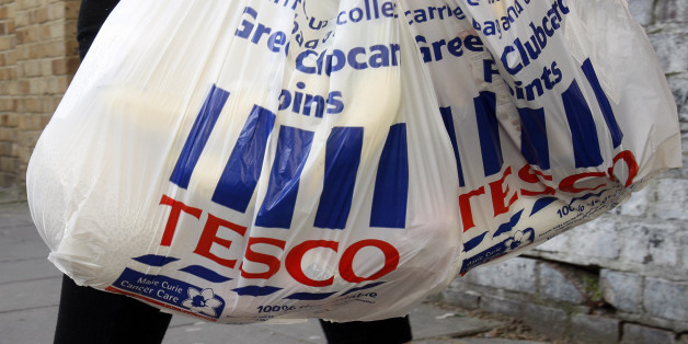 Tesco shopping  bags are carried in London, Tuesday, April 21, 2009. Tesco PLC, Britain's largest retailer has reported full-year profits rose 2 percent to 2.17 billion pounds (US$3.15 billion) despite higher than expected losses on its fledgling U.S. venture. (AP Photo/Kirsty Wigglesworth)