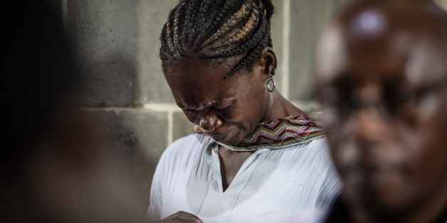 Worshippers gather for an Easter service at the All Saints' Cathedral in Nairobi on April 5, 2015, mourning the country's worst ever massacres, the killing of almost 150 people in an attack on a university by Somalia's Shebab Islamists on April 2, in the northeastern town of Garissa. Kenyans prayed for unity at the start of three days of national mourning for the people murdered in a university massacre. AFP PHOTO /NICHOLE SOBECKI        (Photo credit should read Nichole Sobecki/AFP/Getty Images)