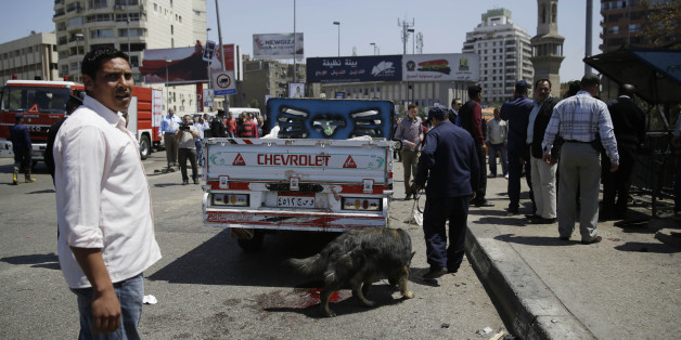 Security personnel use a bomb-sniffing dog at the scene of an explosion that killed at least one person on a bridge over the Nile River, near an upscale neighborhood of Cairo, Egypt, Sunday, April 5, 2015. Attacks mainly targeting Egyptian security forces have spiked since the 2013 military overthrow of Islamist President Mohammed Morsi following massive protests against his divisive rule.  (AP Photo/Hassan Ammar)