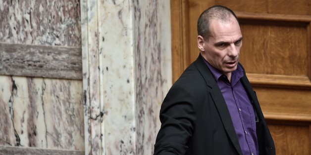 Greek Finance Minister Yanis Varoufakis arrrives on March 18, 2015 at the parliament in Athens. Greece was responding sharply to apparent pressure from the EU not to pass a so-called 'humanitarian crisis' law that would provide free electricity and food stamps for the poorest households. AFP PHOTO / ARIS MESSINIS        (Photo credit should read ARIS MESSINIS/AFP/Getty Images)