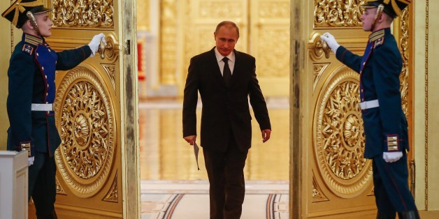 Russian President Vladimir Putin enters a hall before a meeting of the Victory Organizing Committee at the Kremlin in Moscow on March 17, 2015. The meeting focuses on preparations for celebrating the 70th anniversary of the victory in World War II. AFP PHOTO / POOL / SERGEI ILNITSKY        (Photo credit should read SERGEI ILNITSKY/AFP/Getty Images)