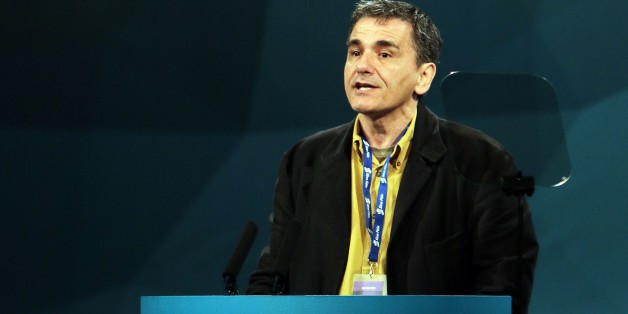 Guest speaker Euclid Tsakalotos of Greek Syriza party addresses the Republican party Sinn Fein annual conference in Londonderry, Northern Ireland on March 7, 2015.  AFP PHOTO / PAUL FAITH        (Photo credit should read PAUL FAITH/AFP/Getty Images)