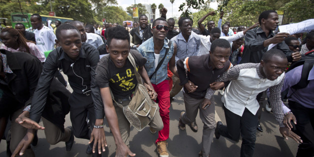 Kenyan students march in memory of the victims of the Garissa college attack and to protest what they say is a lack of security, in downtown Nairobi, Kenya Tuesday, April 7, 2015. Hundreds of Kenyan students marched through downtown Nairobi on Tuesday to honor those who died in the attack on a college by Islamic militants and to press the government for better security in the wake of the slaughter. (AP Photo/Ben Curtis)