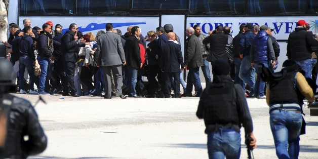 Tourists and visitors line up before being evacuated from the Bardo museum Wednesday, March 18, 2015 in Tunis, after gunmen opened fire at the leading museum in Tunisia's capital. At least 21 people in all were killed, including two gunmen, but some attackers may have escaped, authorities said. (AP Photo/Salah Ben Mahmoud)