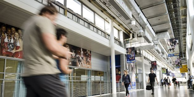 File photo dated 08/04/15 of people walking down the main concourse in the sports science building at the University of Bath, as a survey has found it offers the best student experience in the country.