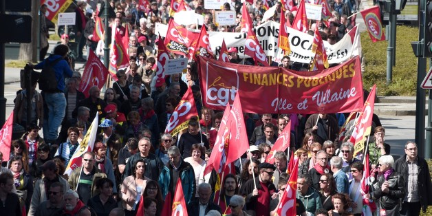 People take part in a demonstration against austerity measures in Rennes, western France  on April 9, 2015 as part of a national strike called by French unions CGT, FO, FSU and Union Syndicale Solidaires. AFP PHOTO / DAMIEN MEYER        (Photo credit should read DAMIEN MEYER/AFP/Getty Images)