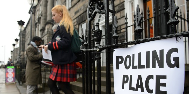 A young voter leaves a polling station after casting her vote in Edinburgh, Scotland, on September 18, 2014, during a referendum on Scotland's independence. Scotland began voting Thursday on whether to become independent, in a referendum that could break up the centuries-old United Kingdom and create Europe's newest country since the collapse of Yugoslavia.  AFP PHOTO / LEON NEAL        (Photo credit should read LEON NEAL/AFP/Getty Images)