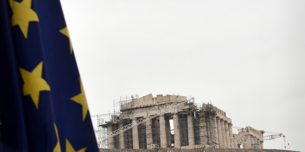 EU flag flies near the Acropolis in Athens on January 1, 2014. Greece on January 1, 2014 began a six-month stint as president of the European Union, as it continues its own struggle against recession and social unrest. Athens assumes the bloc's rotating presidency at a time of change, with elections in May set to usher in a new European parliament amid fears of gains by anti-EU parties. AFP PHOTO / Louisa Gouliamaki        (Photo credit should read LOUISA GOULIAMAKI/AFP/Getty Images)