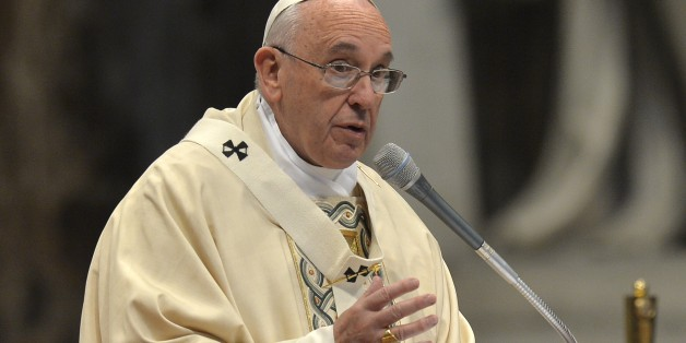 Pope Francis leads a mass for Armenian Catholics marking 100 years since the mass killings of Armenians under the Ottoman Empire, on April 12, 2015 at St Peter's basilica in Vatican. Pope Francis faces a key diplomatic test today as he marks the centenary of the mass killings of Armenians and elects whether to use the word 'genocide', at the risk of alienating Turkey. AFP PHOTO / ANDREAS SOLARO        (Photo credit should read ANDREAS SOLARO/AFP/Getty Images)