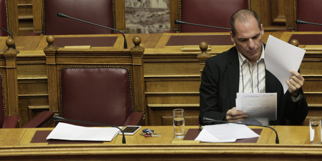 Greek Finance Minister Yanis Varoufakis reads papers during a parliament session in Athens, on Thursday, April 2, 2015. Greece and its international creditors are still struggling to agree on a list of economic reforms that are deemed necessary for the country to unlock emergency funds and stay afloat. (AP Photo/Petros Giannakouris)