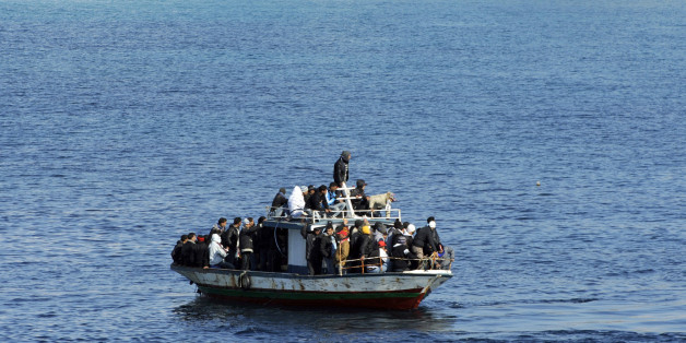 A boatload of would-be migrants believed to be from North Africa is seen moments before being rescued by the Italian Coast Guard in the waters off the Sicilian island of Lampedusa, Italy, Sunday, Feb. 13, 2011. By dawn Saturday, around 3,000 migrants fleeing turmoil in North Africa had arrived by boat on Lampedusa over three days, hundreds more arrived during the day and several more boats were reportedly spotted on the horizon headed for the flat-rock, largely barren fishing island, Italian aut