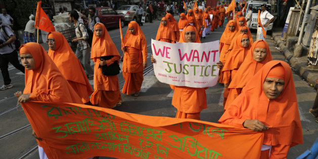 Nuns of Ananda Marga, a spiritual and social service organization, walk in a silent procession protesting the rape of an elderly nun at a convent in Ranaghat, in Kolkata, India, Tuesday, March 17, 2015. A nun in her 70s was gang-raped by a group of bandits when she tried to prevent them from committing a robbery in the Convent of Jesus and Mary School in West Bengal state's Nadia district, according to police. (AP Photo/Bikas Das)