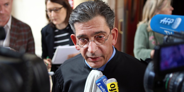 French lawyer Jean-Marc Fedida addresses reporters at the Paris court house, Monday April 13, 2015, after his client, the heiress of the fashion and perfume house Nina Ricci has been sentenced to a year in prison and ordered to pay heavy fines and back taxes for having hidden millions of euros in HSBC bank accounts in Switzerland. A Paris court convicted Arlette Ricci, 73, granddaughter of designer Nina Ricci, of tax evasion and money laundering. (AP Photo/Remy de la Mauviniere)