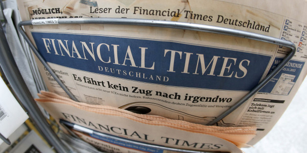 "An edition of the Financial Times Deutschland is seen at a newspaper and tobacco shop in Frankfurt, Germany, Friday, Nov. 23, 2012.  The publisher of the Financial Times' German offshoot says production will be stopped shortly and some 320 employees will lose their jobs.  The Financial Times Deutschland, which has a circulation of about 100,000, was launched at the height of the Internet boom in 2000 but was never profitable. Hamburg-based publisher Gruner + Jahr said in a statement Friday it sees ""no way"" to continue publishing the loss-making paper beyond Dec. 7 amid further falling advertisement revenues.   (AP Photo/Michael Probst)"