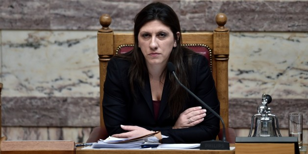 The president of the Greek Parliament, Zoi Konstantopoulou, attends on March 18, 2015 a parliament session in Athens. Greece was responding sharply to apparent pressure from the EU not to pass a so-called 'humanitarian crisis' law that would provide free electricity and food stamps for the poorest households. AFP PHOTO / ARIS MESSINIS        (Photo credit should read ARIS MESSINIS/AFP/Getty Images)