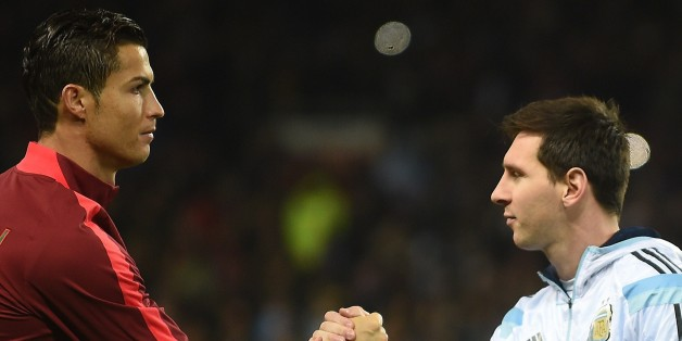 Argentina striker Lionel Messi (R) shakes hands with Portugal's striker Cristiano Ronaldo (L) ahead of kick off of the international friendly football match between the Argentina and Portugal at Old Trafford in Manchester on November 18, 2014. AFP PHOTO / PAUL ELLIS        (Photo credit should read PAUL ELLIS/AFP/Getty Images)