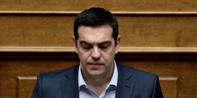 Greek Prime Minister Alexis Tsipras attends a parliament session in Athens on March 30, 2015. The EU warned Monday that Greece and its creditors had yet to hammer out a new list of reforms despite talks lasting all weekend aimed at staving off bankruptcy and a euro exit. AFP PHOTO / ARIS MESSINIS        (Photo credit should read ARIS MESSINIS/AFP/Getty Images)