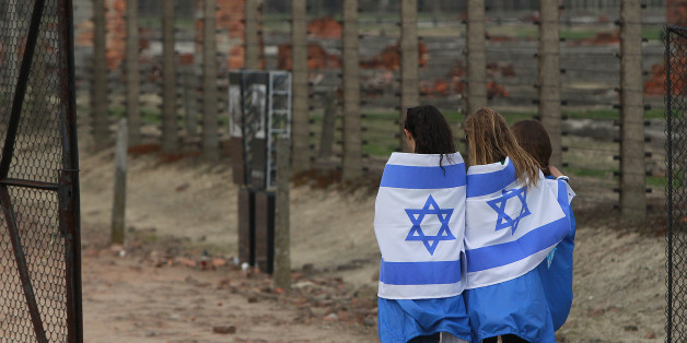 Participants  with Israeli flags  arrive for  the annual silent March of the Living at the  Auschwitz-Birkenau Nazi death camp memorial to honor more than 1 million people, mostly Jews, killed at the camp from 1940-45, in Oswiecim, Poland, Thursday, April 16, 2015. (AP Photo/Czarek Sokolowski)