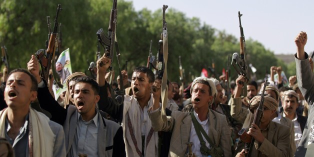 Tribal gunmen loyal to the Shiite Huthi movement raise their weapons on April 16, 2015 in the capital Sanaa during a demonstration against the decision of the UN Security Council two days ago to slap an arms embargo on them. The UN envoy to Yemen has resigned after failing to avert large-scale violence, dealing a blow to hopes of a diplomatic solution to the conflict between Shiite rebels and Saudi-backed government forces.  AFP PHOTO / MOHAMMED HUWAIS        (Photo credit should read MOHAMMED H