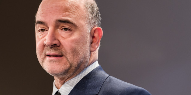 EU Commissioner for Economic and Financial Affairs, Taxation and Customs Pierre Moscovici addresses the media on the winter economic forecast at the European Commission headquarters in Brussels on Thursday, Feb. 5, 2015. (AP Photo/Geert Vanden Wijngaert)