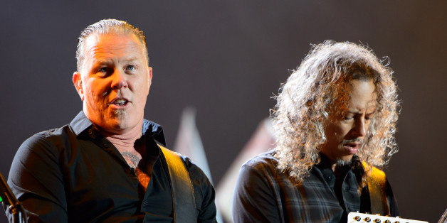 James Hetfield, left and Kirk Hammett, right from U.S band Metallica performs at Glastonbury music festival, England, Saturday, June 28, 2014. Thousands of music fans have arrived for the festival to see headliners Arcade Fire, Metallica and Kasabian. (Photo by Jonathan Short/Invision/AP)