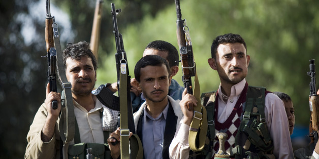 In this Thursday, April 16, 2015 photo, Shiite rebels, known as Houthis, hold up their weapons as they attend a demonstration against an arms embargo imposed by the U.N. Security Council on Houthi leaders, in Sanaa, Yemen. (AP Photo/Hani Mohammed)