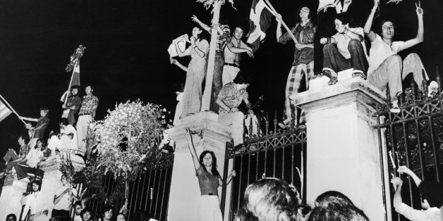 GREECE - AUGUST 27:  Greeks celebrating the capitulation of the military dictatorship before the polytechnic school in Athens on July 26, 1974. The civil government of Prime Minister Constantine KARAMANLIS replaced the dictatorship.  (Photo by Keystone-France/Gamma-Keystone via Getty Images)