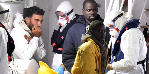 CATANIA, ITALY - APRIL 20:  (L) Tunisian skipper Mohammed Ali Malek stands on the deck of the Italian Coast Guard ship Gregretti which is carrying 27 survivors of the migrant shipwreck in the mediterranean, at Catania port on April 20, 2015 in Catania, Italy. The weekend saw the worst disaster of its kind as hundreds of migrants are believed to have perished as they attempted to cross the mediterranean from Libya to Italy in order to seek refuge. Tunisian skipper Mohammed Ali Malek, was arrested