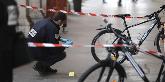 A police officer collects clues after an attacker with a knife hidden in his bag attacked three soldiers on an anti-terror patrol in front of a Jewish community center in Nice, southern France, Tuesday Feb.3, 2015 . France has been on high alert since the attacks in the Paris region by three Islamic extremists that left 20 people dead, including the gunmen. More than 10,000 soldiers have been deployed around the country to protect sensitive locations, including major shopping areas, synagogues, mosques and transit hubs. (AP Photo/Lionel Cironneau)
