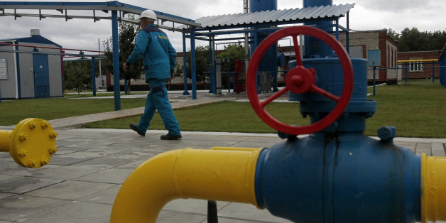 A worker at a boosting compressor station ''East-Poltava'' near the village of  Kovalivka, Poltava region some 357 kilometers of Kiev, Ukraine, Friday, June 27, 2014.   Russia's state-controlled gas company, Gazprom, warned its European customers Friday that it could limit supplies to those European countries that intend to re-sell the natural gas on to Ukraine. (AP Photo/Sergei Chuzavkov)