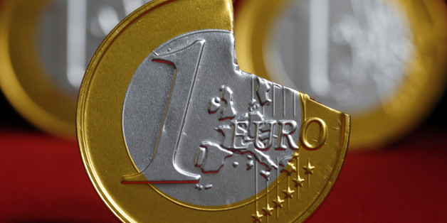 A picture taken on June 16, 2012 in Paris, shows a one-euro coin with a piece broken off. AFP PHOTO THOMAS COEX        (Photo credit should read THOMAS COEX/AFP/GettyImages)