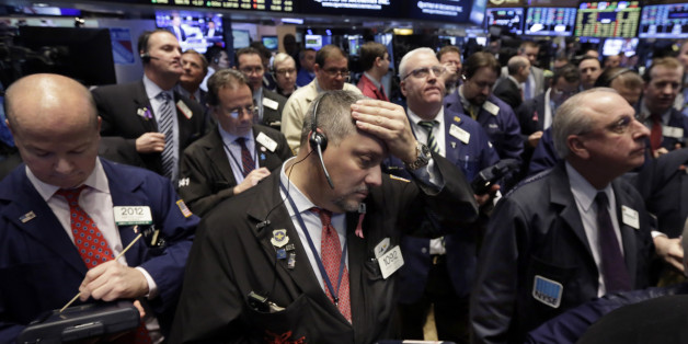 Traders work on the floor of the New York Stock Exchange, Tuesday, March 24, 2015. U.S. stocks were mixed in early trading Tuesday, as investors assessed the latest news on consumer prices and some company earnings. (AP Photo/Richard Drew)