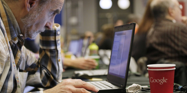 A man works on a laptop Google at Google offices, Oct. 17, 2012 in New York. (AP Photo/Mark Lennihan)