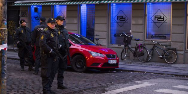 Armed police stand guard outside an internet cafe that was raided in connection with the twin attack on a freedom of expression meeting and the main Synagogue in Copenhagen on February 15, 2015.  Two fatal shootings in the Danish capital, at a cultural center during a debate on Islam and free speech and a second outside the city's main synagogue. France's ambassador to Denmark Francois Zimeray, who was attending the debate, told AFP the attackers were seeking to replicate the January 7 assault by jihadists in Paris on satirical newspaper Charlie Hebdo that left 12 dead. AFP PHOTO / ODD ANDERSEN        (Photo credit should read ODD ANDERSEN/AFP/Getty Images)