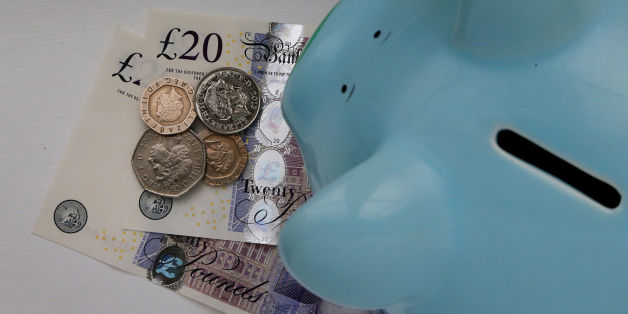 File photo dated 06/01/15 of money in a piggy bank, as the UK population is spending more and has a greater amount of money available to save each month after paying direct taxes, a quarterly health check of the country's economic well-being has shown.