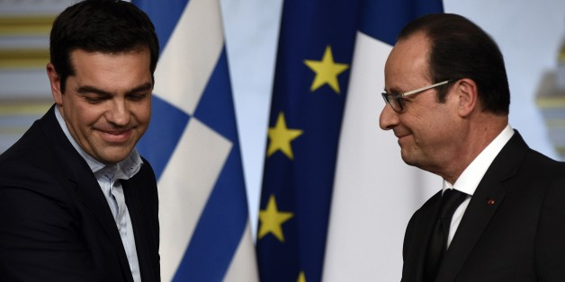 French president Francois Hollande (R) and Greece's Prime Minister Alexis Tsipras are seen during a press conference at the Elysee presidential palace, on February 4, 2015 in Paris. AFP PHOTO MARTIN BUREAU        (Photo credit should read MARTIN BUREAU/AFP/Getty Images)