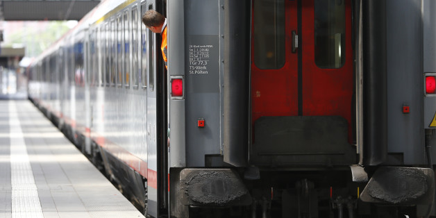 An employee of Deutsche Bahn look out of a train during a train drivers strike at the central station in Munich, Germany, Thursday, April 23, 2015. The GDL union said passenger services will be hit from 2 a.m. (0000 GMT) Wednesday until 9 p.m. (1900 GMT) Thursday. (AP Photo/Matthias Schrader)