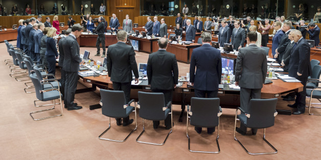 European Union heads of state observe a moment of silence during a round table at an emergency EU summit in Brussels on Thursday, April 23, 2015. EU leaders are facing calls from all sides to take emergency action to save lives in the Mediterranean, where hundreds of migrants are missing and feared drowned in recent days. (AP Photo/Geert Vanden Wijngaert)
