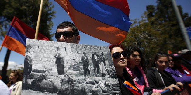 Members of the Armenian community hold the Armenian flags and placards during a demonstration on April 24, 2015 infront of the Turkish consulate in Jerusalem, to commemorate the 100th anniversary of the mass killings of Armenians under the Ottoman Empire in 1915. Armenia says an estimated 1.5 million people were killed by Ottoman forces in what it calls a genocide. AFP PHOTO/GALI TIBBON        (Photo credit should read GALI TIBBON/AFP/Getty Images)