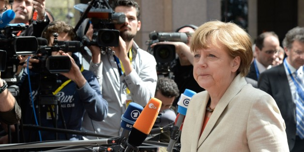 Germany's Chancellor Angela Merkel arrives at the European Council headquarters for an extraordinary summit of European leaders to deal with a worsening migration crisis, on April 23, 2015 in Brussels. European leaders gather on April 23 to consider military action, at an extraordinary summit to deal with a worsening migration crisis after a series of deadly shipwrecks in the Mediterranean.   AFP PHOTO / THIERRY CHARLIER        (Photo credit should read THIERRY CHARLIER/AFP/Getty Images)