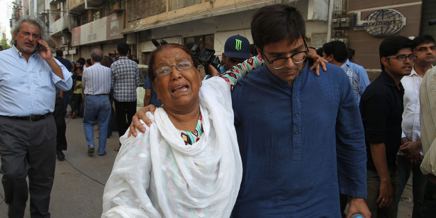 A woman mourns after attending the funeral prayers of prominent women's rights activist Sabeen Mehmud, who was killed by unknown gunmen in Karachi, Pakistan on Saturday, April 25, 2015. Gunmen on a motorcycle killed Mehmud in Pakistan just hours after she held a forum on the country's restive Baluchistan region, home to a long-running insurgency, police said Saturday. (AP Photo/Fareed Khan)