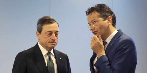 Eurogroup president Jeroen Dijsselbloem, right, and President of the ECB, Mario Draghi talk during the Informal Meeting of Ministers for Economic and Financial Affairs of the European Union in Riga, Latvia on Friday, April 24, 2015. Greece's finance minister came under fire Friday from his peers in the 19-country eurozone for failing to come up with a comprehensive list of economic reforms that are needed if the country is to get vital loans to avoid going bankrupt. (Dmitris Sulzics/F64 Photo Agency via AP)