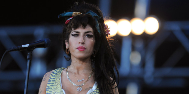 British singer Amy Winehouse performs during the 'Rock in Rio' music festival in Arganda del Rey near Madrid on July 04, 2008. AFP PHOTO/ PIERRE-PHILIPPE MARCOU (Photo credit should read PIERRE-PHILIPPE MARCOU/AFP/Getty Images)
