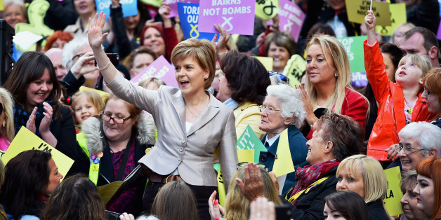 GLASGOW, SCOTLAND - APRIL 25:  SNP Leader Nicola Sturgeon joins female activists in Buchanan Street SNP along with actor and campaigner Elaine C Smith to launch the SNP's women's pledge, committing the SNP and its members to delivering policies that promote equality on April 25, 2015 in Glasgow, Scotland.  (Photo by Jeff J Mitchell/Getty Images)