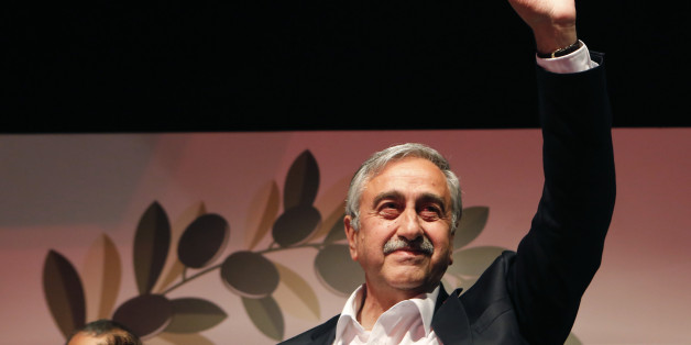Turkish Cypriot newly elected leader Mustafa Akinci waves to his supporters after won the leadership election in Nicosia in the Turkish Cypriot breakaway north part of the divided island of Cyprus, Sunday, April 26, 2015. Akinci, a veteran politician with a strong track record of reaching out to rival Greek Cypriots, was elected as leader of the breakaway Turkish Cypriots in ethnically divided Cyprus. Akinci defeated hard-line incumbent Dervis Eroglu with 60.38 percent of the vote, preliminary official results showed. Turnout for Sunday's vote was just over 64 percent. (AP Photo/Petros Karadjias)