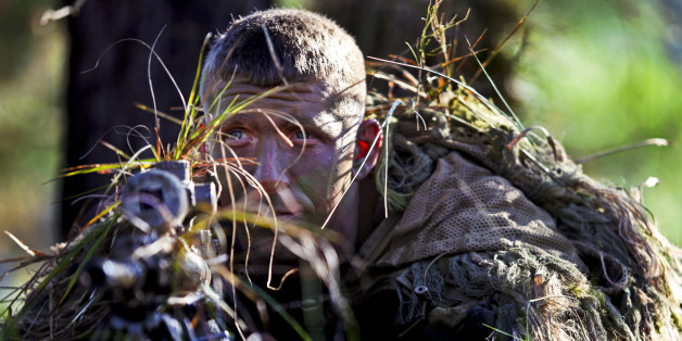 Army Staff Sgt. Mathew Fox waits to engage a target in the live-fire stalk event during the 2012 International Sniper Competition at the U.S. Army Sniper School on Fort Benning, Ga., Nov. 3, 2012. Fox, a sniper, is assigned to the 3rd Infantry Division's 3rd Brigade, 2nd Battalion, 69 Armor Regiment. U.S. Army photo by Ashley Cross